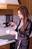 Beautiful young female make coffee Royalty Free Stock Images