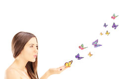 Beautiful young female with many colorful butterflies Stock Photos