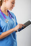 Beautiful young female medical intern with tablet Stock Photo