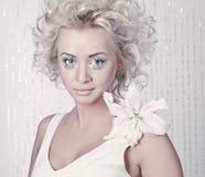 Beautiful young female with original make up Stock Photos