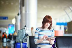Beautiful young female passenger at the airport Stock Photography