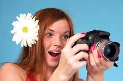 Beautiful young female photographer Stock Photo