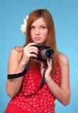 Beautiful young female photographer Stock Image