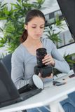 Beautiful young female photographer checking pictures on camera. Beautiful young female photographer checking pictures on her camera Royalty Free Stock Photos