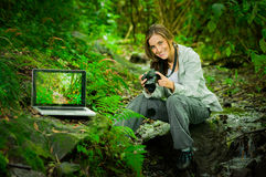 Beautiful young female photographer in the jungle Stock Photo