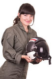 Beautiful young female pilot holding helmet Stock Image