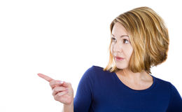 Beautiful young female pointing at a copy space Royalty Free Stock Images