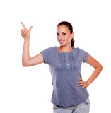 Beautiful young female pointing up and looking you Royalty Free Stock Images