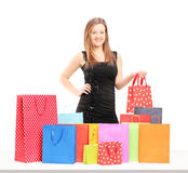 Beautiful young female posing with shopping bags Royalty Free Stock Photography