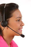 Beautiful young female receptionist on telephone Royalty Free Stock Photo