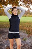 Beautiful young female runner in autumn park stock image
