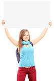 Beautiful young female with school backpack holding a white pane Royalty Free Stock Images