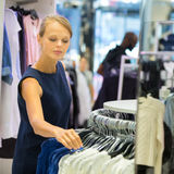 Beautiful young female shopper in a clothing store Stock Image