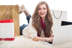 Beautiful and young female shopper using laptop Royalty Free Stock Photos