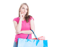 Beautiful young female at shopping thinking what to buy Stock Images