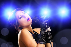 Beautiful young female singer in black dress singing Royalty Free Stock Images
