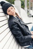 Beautiful young female sitting on the bench park Stock Image