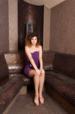 Beautiful young female sitting and relaxing hammam Royalty Free Stock Photo