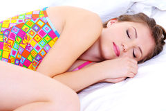 Beautiful young female sleeping snuggle royalty free stock photography