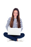 Beautiful young female student with a laptop Royalty Free Stock Photos