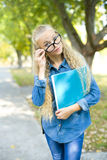 Beautiful young female student in a park Royalty Free Stock Photo