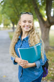 Beautiful young female student in a park Royalty Free Stock Image