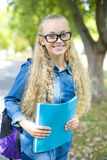 Beautiful young female student in a park Royalty Free Stock Photos