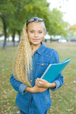 Beautiful young female student in a park Stock Photo