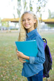Beautiful young female student in a park Stock Images