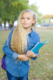 Beautiful young female student in a park Stock Photography