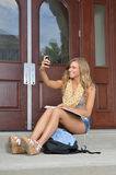 Beautiful young female student takes a selfie Stock Images