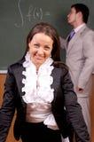 Beautiful young female teacher Stock Image