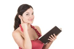 Beautiful young female teacher holding book Royalty Free Stock Photos