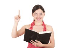 Beautiful young female teacher holding book Stock Photo