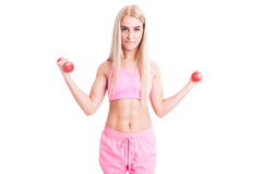Beautiful and young female trainer holding weights Stock Images