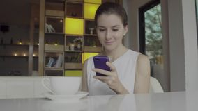 Beautiful young female using smartphone stock photography
