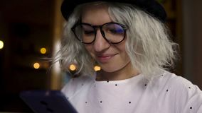 Beautiful young female using smartphone. And smiling stock video footage