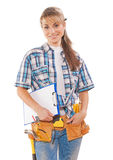Beautiful young female worker with construction tools holding cl. Ipboard smiling and looking at camera isolated on white background Stock Photos