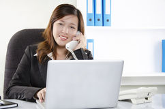 Beautiful young female working in office Stock Photos