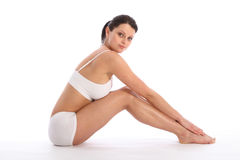 Beautiful young fit body of sports woman sitting Stock Images