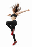 Beautiful young fit modern dancer lady dancing with her long hair flying Royalty Free Stock Photo