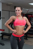 Beautiful young fit woman smiling and posing at the gym Royalty Free Stock Photo