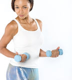 Beautiful young fit woman working out with dumbbells Royalty Free Stock Photography