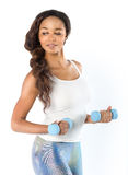 Beautiful young fit woman working out with dumbbells Stock Photo