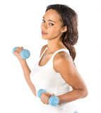 Beautiful young fit woman working out with dumbbells Stock Photos