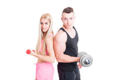 Beautiful and young fitness couple holding weights Stock Photography