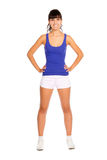 Beautiful young fitness trainer. Standing  isolated over white background Royalty Free Stock Photo