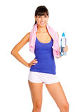 Beautiful young fitness trainer. Young woman with bottle in the hand after fitness. Isolated over white Royalty Free Stock Photography