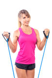 Beautiful young fitness trainer standing isolated over white bac Stock Image