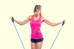 Beautiful young fitness trainer standing isolated Stock Image